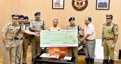UPCM को केरल राज्य के बाढ़ प्रभावितों के सहायतार्थ DGP ने 11 करोड़ रु. का चेक भेंट किया